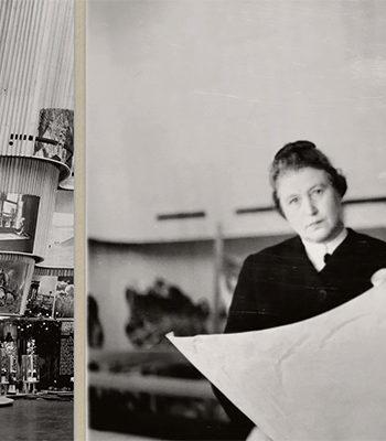 Rakennus ja nainen, mies ja iso paperi / A building and a woman, man and a big paper