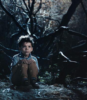 Poika istuu pimeässä / A boy sits in the dark