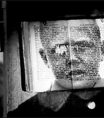 Avonainen kirja ja pojan pää / Open book and a head of a boy